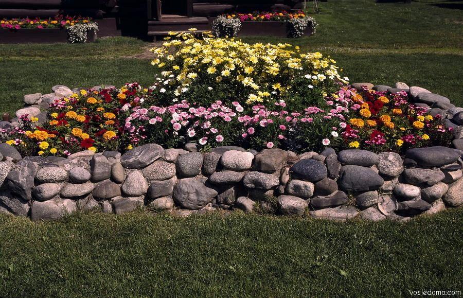Ограждение для клумбы из камня